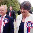 DUP leader Arlene Foster and Lord Morrow arrive at the Omagh Leisure Complex