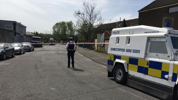 The scene at the Distillery Court area in West Belfast, where a man was shot