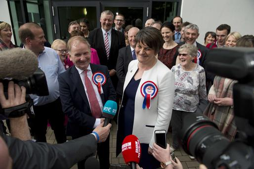 First Minister Arlene Foster and party colleague Lord Morrow celebrate with supporters after being elected in Fermanagh/South Tyrone