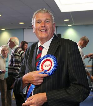The DUP's Jim Wells enjoys the moment after being re-elected to the Assembly