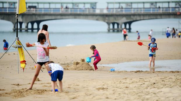 Children enjoy the sunshine on Bournemouth beach