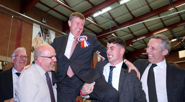 DUP's Mervyn Storey is congratulated at Ballymena count