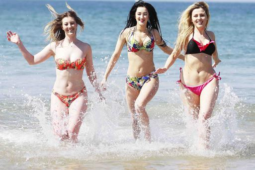 Having a splashing time are students Francesca Morelli, Chloe McMaster and Ruby Black as they take advantage of the 22C heat in Portrush