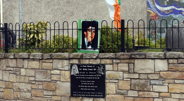 The memorial plaque to Bobby Sands in Rosslea, with Seamus McElwain's photo above it