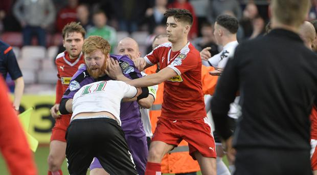 Cliftonville's Conor Devlin and Glentoran's Chris Lavery clash last night