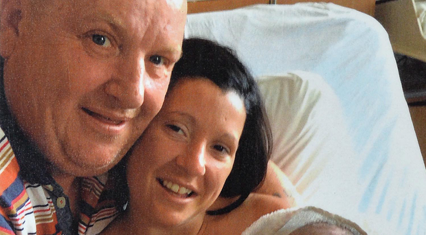 Nurdered takeaway driver Dan Murray with his partner Ciara Austin at the birth of their son Podraig (now 2)