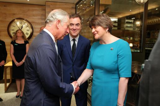 First Minister Arlene Foster greets Prince Charles as James Nesbitt looks on in Fortnum & Mason in Piccadilly, London, yesterday before the trio toured the store and sampled some NI produce along the way