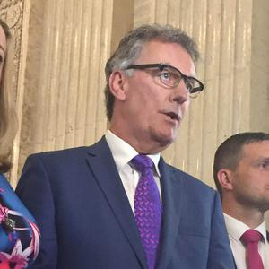 UUP leader Mike Nesbitt (centre) speaking to the media in Great Hall of Parliament Buildings, Stormont, Belfast