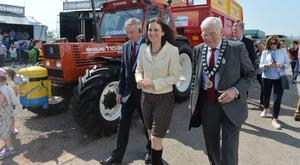 Secretary of State Theresa Villiers with RUAS president Billy Robson (right) and chief executive Colin McDonald yesterday