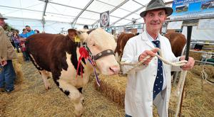 A proud owner with his prize bull at the Balmoral Show