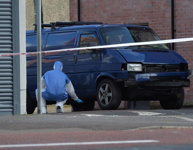 Prison officer Adrian Ismay is seriously injured after a booby-trap bomb explodes underneath his van in east Belfast