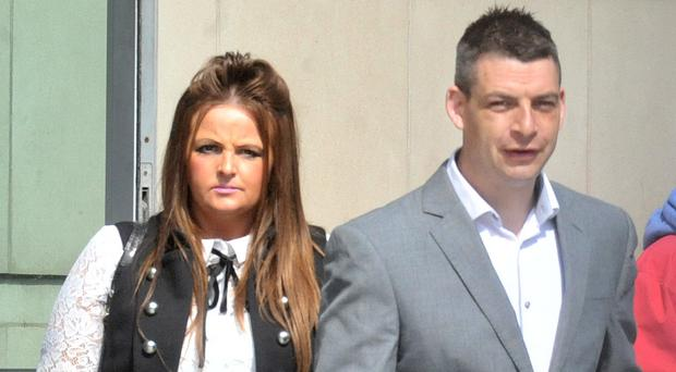 Lisa and Gary Thompson leaving court