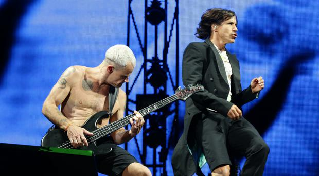Flea and Anthony Kiedis on stage at the Isle of Wight Festival in 2014