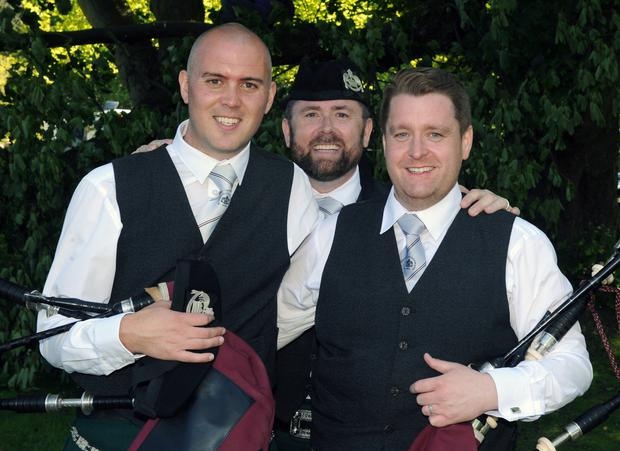 Alan Tully (pipe major), Philip Tasker (pipe sergeant) and Stephen Crieghton (lead drummer) of St Laurence O'Toole Pipe Band