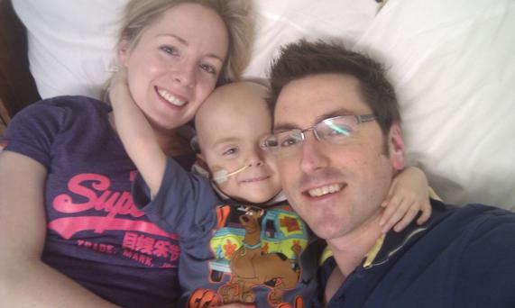Oscar with mum Leona and dad Stephen