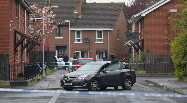 Police at the scene of the murder of Dan Murray in west Belfast