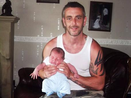 One of Yasmin's treasured photos of partner Leigh McCaughan with son their Carter