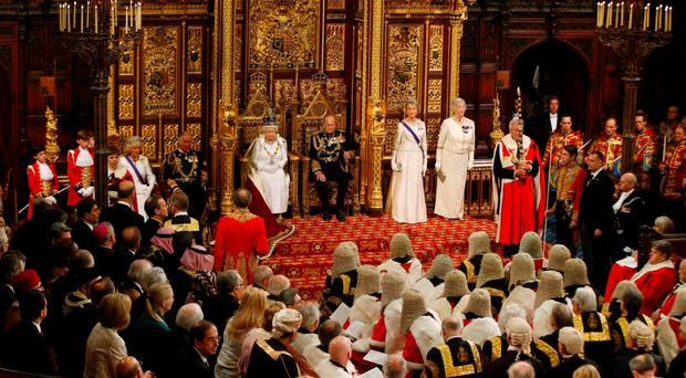 The Queen sits on the throne waiting for members of the House of Commons to arrive