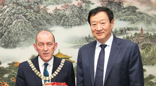 Lord Mayor of Belfast Arder Carson meets the Mayor of Shenyang Pan Liguo, as they sign a Sister City Agreement in Shenyang, China (Belfast City Council/PA)