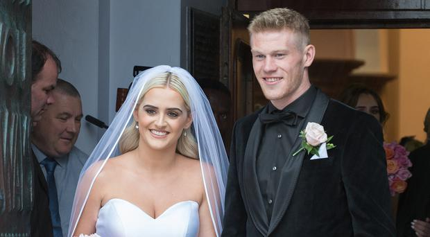 Premier League star James McClean with new wife Erin Connor at Saint Columb's Church in Derry yesterday