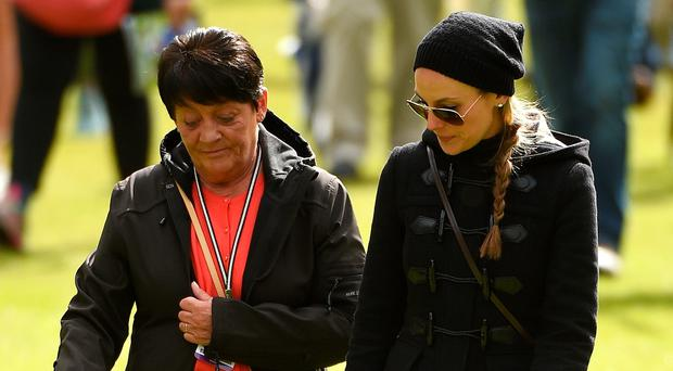 Rory's mother Rose and his fiancee Erica Stoll follow his group during the second round of the Dubai Duty Free Irish Open