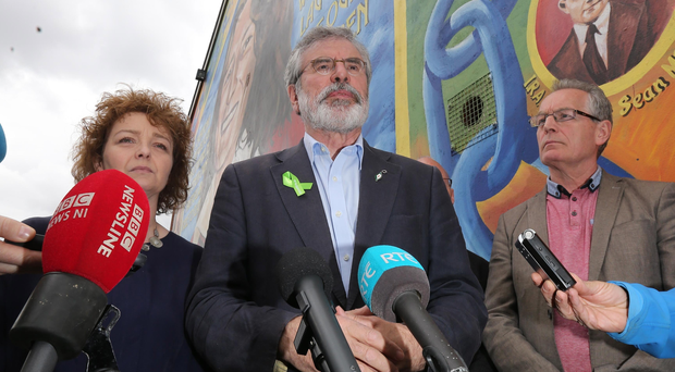 Gerry Adams speaks to the media in west Belfast yesterday alongside MLAs Caral Ni Chuilin and Gerry Kelly
