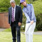 Rising young golf star Tom McKibbin with NI Hospice chairman Billy Webb