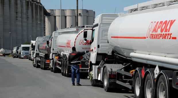 Tanker drivers wait to refuel at the entrance of the tanker depot at La Rochelle in France