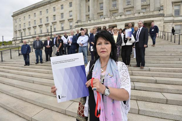 Abuse survivor Margaret McGuckin on the steps of Stormont at the launch of the 'A Compensation Framework for Historic Abuses in Residential Institutions' document