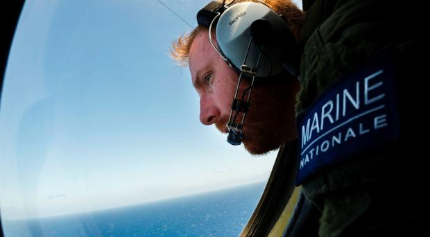 A French soldier aboard an aircraft scouring the Mediterranean Sea for debris from the crashed EgyptAir flight