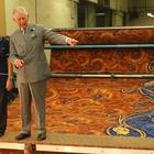 The Prince of Wales looks at a carpet during a visit to Ulster Carpets in Craigavon.