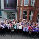 Staff and volunteers celebrate the opening of the new Northern Ireland Hospice on Somerton Road in north Belfast