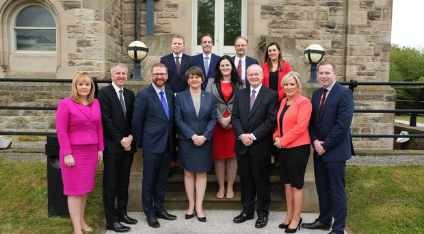First Minister Arlene Foster and Deputy First Minister Martin McGuinness with Executive colleagues ahead of the first Executive meeting yesterday at Stormont Castle, (from left) Michelle McIlveen; Mairtin O Muilleoir; Simon Hamilton; Alastair Ross; Paul Givan; Claire Sugden; Peter Weir; Megan Fearon; Michelle O'Neill; and Chris Hazzard