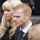 Jordan Higgins with his sister Lauren at the funeral of their father Alex in 2010