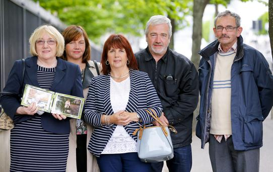 Nula Mulholland, Jackie Loughran, Monica McCarthy, Sean McEneaney and Cahal McEneaney with a photograph of their mum Rosaline McEneaney