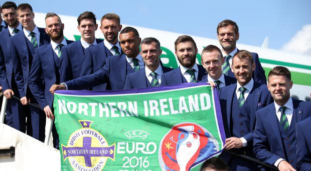 Northern Ireland players line up on the steps of their chartered plane before setting off to their training camp in Austria