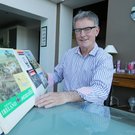 Ulster Unionist Party leader Mike Nesbitt at his home yesterday looking through some of the Mexico 1986 memorabilia