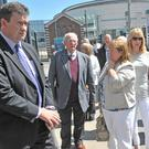 May, with other bereaved families, emerges from the courthouse after the hearing