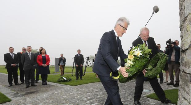Deputy First Minister Martin McGuinness, back, laying a wreath alongside minister-president of Flanders Geert Bourgeois at the First World War monument in Belgium (Sinn Fein/PA)