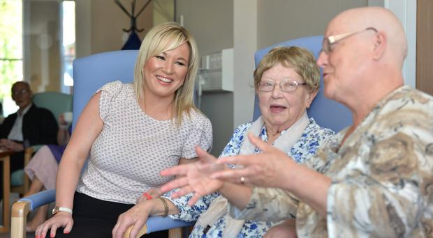 Health Minister Michelle O'Neill chats to patients at the NI Hospice yesterday