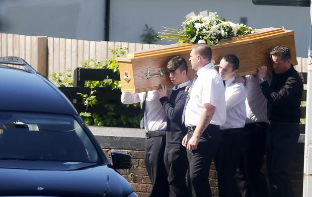 Donna Brown's coffin is carried by family and friends yesterday