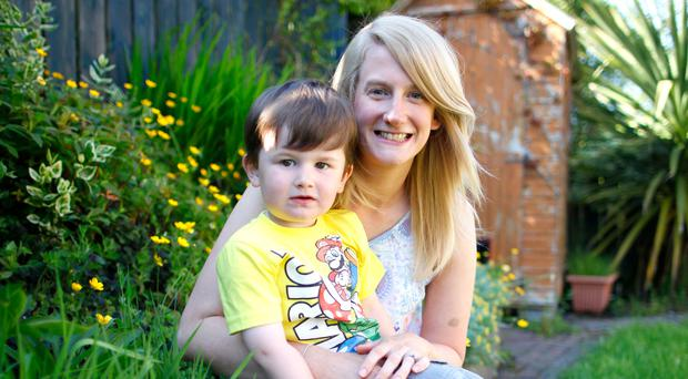 Lindsay Robinson wife of DUP's Gavin Robinson with their son Rubin. pic by Peter Morrison