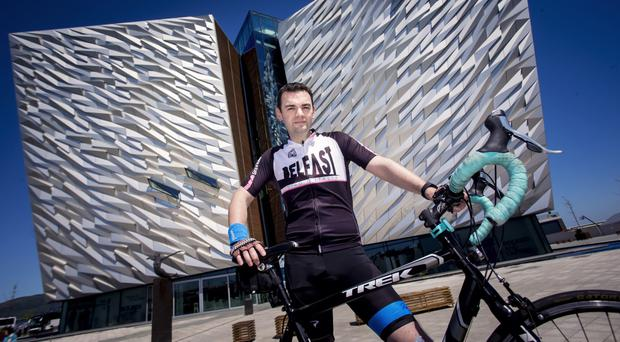 Tele journalist Jonny Bell prepares for the race outside Titanic Belfast