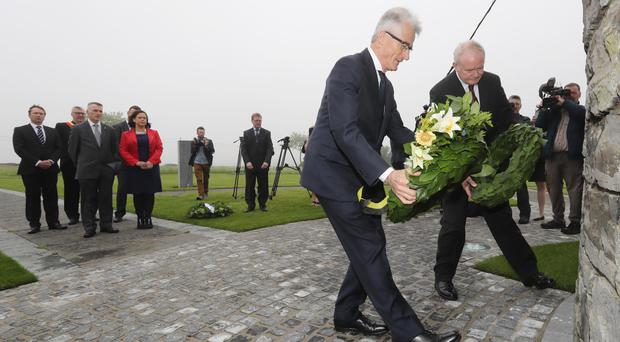 Deputy First Minister Martin McGuinness lays a wreath with Minister-President of Flanders Geert Bourgeois at the Island of Ireland Peace Park, Messines