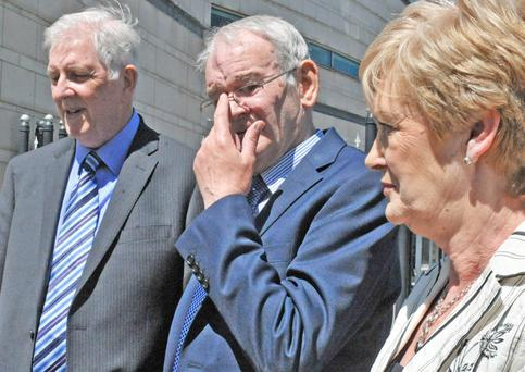 Retired schoolteachers Gerry McKeown (left) and his wife Anne, with Kingsmills survivor Alan Black outside Belfast Coroner's Court