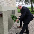 Martin McGuinness lays a wreath at the Ulster Memorial Tower yesterday for those who lost their lives in World War One