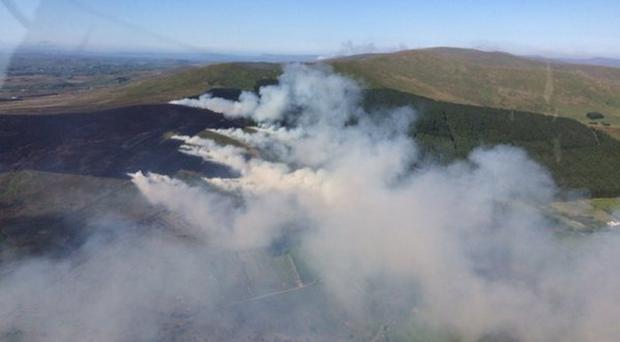 Thick plumes of smoke rise from the gorse fire in the Dunnyboe area of Co Tyrone