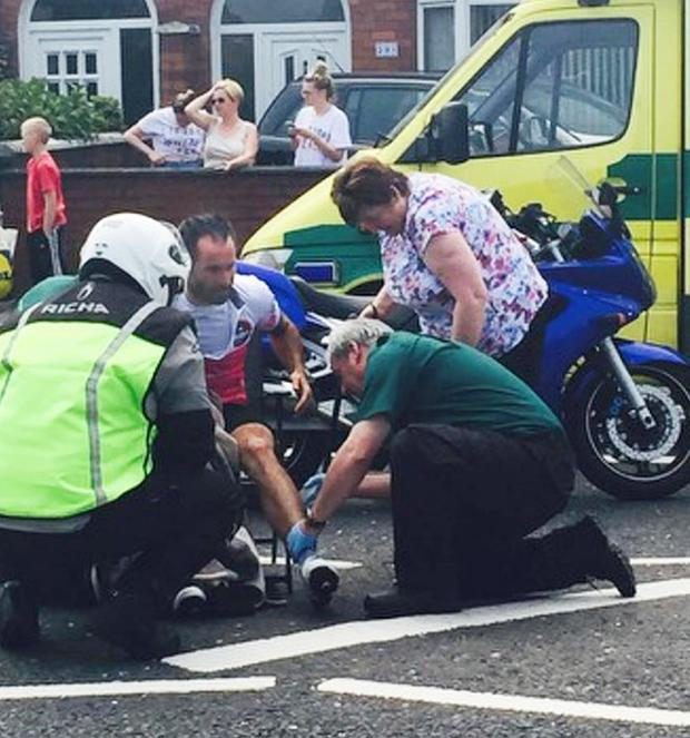 David Mulholland is treated after the collision with a car in Belfast