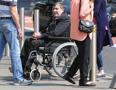 Winston 'Winkie' Rea in a wheelchair outside earlier court hearing