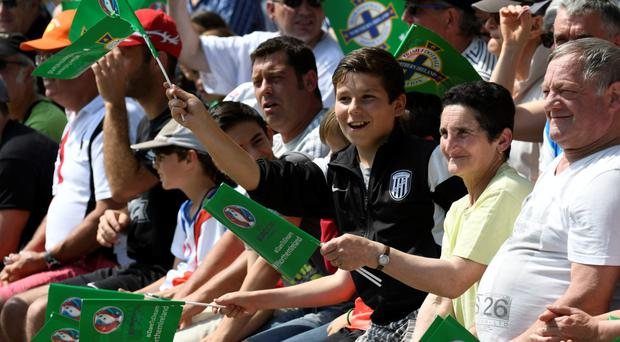 Fans wave flags as they watch Northern Ireland and meet some of the players at their training ground in Saint George de Reneins yesterday